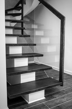 A solid steel staircase that was installed in a home in Horten.  Oiled steps of solid oak and glass balustrades forms here a timeless and durable performance for the future. #Wooden #Stairs #Staircase #InteriorDesign #BlackAndWhite #Minimalism