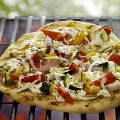 Take advantage of seasonal produce with this grilled vegetable pizza that combines a variety of colorful bell peppers, zucchini and fresh ricotta and mozzarella. Pizza Recipes, Grilling Recipes, How To Cook Zucchini, Cooking Zucchini, Cooking Lamb Chops, Great Recipes, Healthy Recipes, Favorite Recipes, How To Cook Lamb