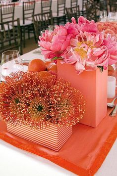 This reception table centerpieces takes a monofloral approach with the use of bright pincushions and pink peonies. By Colin Cowie Celebrations Delray Beach Florida, Reception Decorations, Event Decor, Reception Table, Deco Orange, Coral Orange, Coral Color, Coral Pink, Tropical Centerpieces