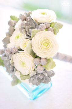 DK Designs - winter inspired bouquet with silver succulents, silver brunia, creamy ivory ranunculus and Dusty Miller leaves.