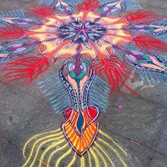 Joe Mangrum pours his colorful, mandala-like sand art along the surface of sidewalks and museum floors.
