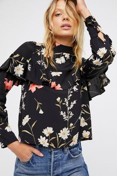 Melanie Top | Pretty floral long sleeve top featuring a femme ruffle detail, high neckline and back cutouts.    * Lightweight, semi-sheer fabrication