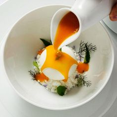 Pumpkin soup with white chocolate, lime, coconut, and duck confit by chef Steven Greene of restaurant Herons from North Carolina