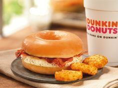 """According to the Associated Press, Dunkin' Donuts is rolling out its new """"Glazed Donut Breakfast Sandwich"""" nationwide. The item consists of a glazed donut, which has been cut in half to mimic a bagel sandwich. In between the donut halves is Bacon Breakfast Sandwiches, Bacon And Egg Sandwich, Egg Sandwiches, Bacon Egg, Smoked Bacon, Fast Food Breakfast, Breakfast Dessert, Breakfast Recipes, Breakfast Ideas"""