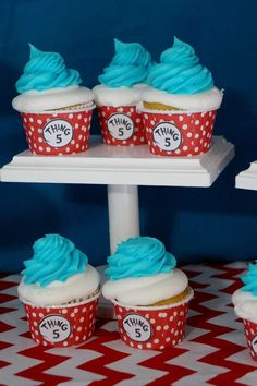 Thing 1 and 2 cupcakes at a Dr. Seuss Cat in the Hat birthday party! See more party planning ideas at CatchMyParty.com!