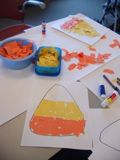color scrap pieces to fill a shape... working on color theme, tearing and fine motor skills.