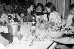 Lou Reed, Mick Jagger and David Bowie at Café Royale, London, 1973, by Mick Rock.