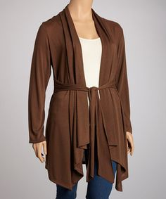 Cozy up to this comfy cardigan for a chic topper that polishes any ensemble to pretty perfection. Featuring soft folds of fabric, a sash-tied waist and a hint of stretch from spandex, this sleek piece creates a lovely layered look. Size note: This item runs a size small. Please refer to size chart.