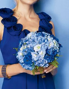 Brides.com: . This spherical bouquet spans the blue spectrum, blending Dutch hydrangeas, delphiniums, tree ferns, and pepper grass; about $275, Belle Fleur, NYC. Bracelet, about $348, Roberta Chiarella.