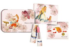 "Paul & Joe Alice in Wonderland Tin in #001 Milky Pink with Blotting Paper, Blotting Paper refills, and refillable Lip Treatment (Spring 2010 ""Alice in Wonderland"" collection, $42.43). The blotting papers have a printed floral design, but they are pretty rubbish (more waxed paper feeling than absorbent). I wish Paul & Joe had refills for the Lip Treatment rather than just the lipsticks. But I love A, so I love the design."