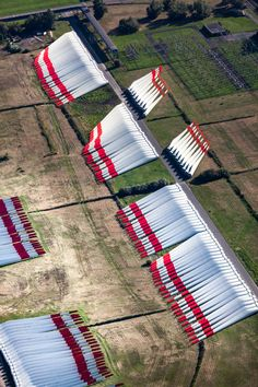 Wind turbine blades stockpiled at a port facility along the Elbe River in Stade, Germany.