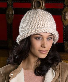 This easy toque is knit in the round with a rolled brim edge. So it works up quickly and with maximum style rewards!