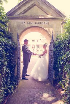 Italian Villa Wedding venue Photographs of bride and groom under archway. Photography by one thousand words wedding photographers