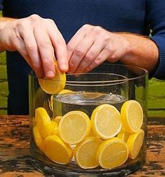 Easy and simple table decoration of a vase within a vase with sliced lemons in between. Place another vase inside, between the lemons and the outer vase. Dollar Tree vase and a half gallon mason jar! Table Centerpieces, Wedding Centerpieces, Table Decorations, Summer Centerpieces, Fruit Centerpiece Ideas, Lime Centerpiece, Dollar Tree Centerpieces, Graduation Centerpiece, Quinceanera Centerpieces