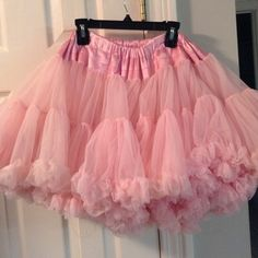 Pink Tutu Lots of layers. has a bow in the back. it stretches a lot. measures 10 inches. expands to like 17 inches. 16 inches in length.This tutu works for a wide range of sizes because of the elastic..It was a $100 item kaiya eve Skirts Midi