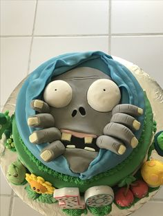 I made this Plants vs Zombies cake for my son's 10th birthday. It's a chocolate cake with chocolate ganache, & covered with fondant. The figures (except the pea shooter & lily pad, which my 6yr old made out of clay) were made out of gum paste. Fingers & face were fondant. Eyes were rice krispie treats covered with fondant. I've never made a layered cake, used fondant, or gum paste so I think it turned out great!! It was good too!