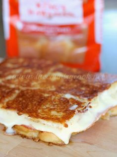 Inside-Out Grilled Cheese from The Country Cook. King's Hawaiian Rolls filled with gooey cheese and ham and a bit of seasoning!