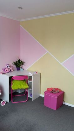 Geometric feature wall in 5 year old girls bedroom
