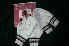 Set of lover's mittens; one left hand one right hand and one with two cuffs for holding hands