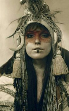 This woman's face is covered in paint and markings, much like a tribal warrior would. Fashion Fotografie, War Paint, Warrior Princess, Headdress, Character Inspiration, Steampunk, Portraits, Cosplay, Poses