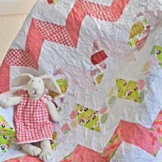 Havana chevron quilt designed by Melissa Lunden of Lunden Designs. Bunny's dress by Olive Ann Designs.