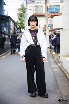 Mitsuki is an 18-year-old student we met while walking along the street in Harajuku. Her black and white minimalist style caught our eye. Mitsuki's outfit features a black resale The Black Dahlia Murder metal t-shirt underneath a white Zara button down shirt, black used/resale pants, and platform shoes. Her accessories include large hoop earrings, silver arm bangles, and a black belt, some of which are from H&M.  Mitsuki's favorite brand is Zara and she likes listening to K-pop music.