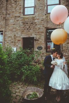 The bride wears a 1950's inspired lace dress for her village hall wedding in Yorkshire. Photography by Shutter Go Click.