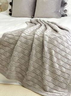 Free Knitting Pattern for Easy Cozy Triangle Throw - This easy afghan features triangle texture in knit and purl stitches with a 16 row repeat – though the 8 wrong side rows are just purl. Quick knit in super bulky yarn. Rated easy by Bernat.