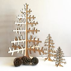 Our laser cut Scandi inspired Christmas trees look great on their own or decorate them with seed lights and decorations! #lasercut #christmas #christmastree #scandi by inscribedesign