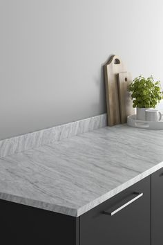 Looking for grey marble countertops ideas? Our Howdens Tempest Grey Marble Effect Laminate Worktop looks amazing when paired with a black slab kitchen and chrome kitchen hardware. These grey marble effect kitchen countertops are affordable and are perfect for creating texture in your modern kitchen design. Howdens Worktops, Kitchen Worktops, Kitchen Hardware, Marble Effect, Work Surface, Marble Countertops, Modern Kitchen Design, Floating Nightstand, Chrome