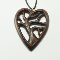 "Tree of Life Heart Pendant Hand carved Sono wood Tree Of Life Heart Pendant with adjustable necklace cord to fit all sizes. Approximately 2"" Length by 1.5"" Width. Jewelry Necklaces"