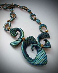 "I made this necklace based on my ""Shapes"" eBook - Spiral Design 2 - for a potential workshop.  This is one of the most popular shapes from the book.  I had fun coming up with the spiral threesome.  I also really like the smaller beads - so easy but really complement the piece.  What did I use for the texture?  The edge of a Popsicle stick!"