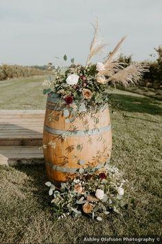 Winery wedding ceremony decor idea - barrel decor with greenery floral arrangement - outdoor wedding ceremony decor - See more details from Dan and Alyson's wedding on WeddingWire! {Ashley Olafsson Photography}
