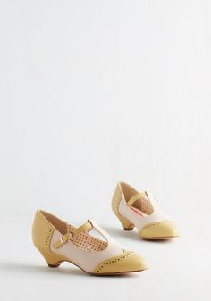 Care to Dance? Heel in Matte Yellow. When your plans involve cutting a rug with your date, buckle into these two-toned heels by Bait Footwear! #yellow #modcloth
