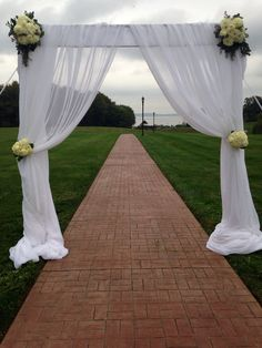 Simple and elegant ceremony arch.  Floral Impressions  Hunt Valley, MD  410-329-1406