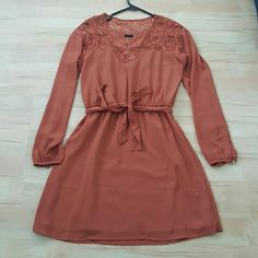 Dressy dress Brand: forver 21 x size: xs (I'm a small & this dress runs large) x rust color x gold details x lace x never worn x brand new without tags Forever 21 Dresses Long Sleeve