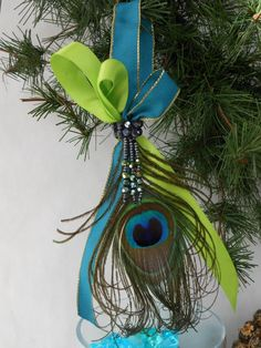 Single peacock feather ornament with beads and by hillsdesign Peacock Christmas Decorations, Peacock Christmas Tree, Peacock Ornaments, Peacock Crafts, Peacock Decor, Feather Crafts, Noel Christmas, Diy Christmas Ornaments, Christmas Colors