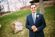 Groom with slate blue tie and pocket square. Photo by Brian Bossany Photography.