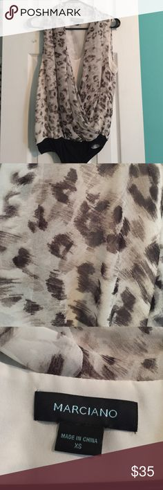 Black Marciano leopard print bodysuit Super chic printed bodysuit with built in white Cami underlay. Never been worn and in excellent condition. Marciano Tops