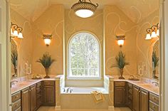 An elegant stenciled look flanks a Palladian window in this master bath. Newly built homes in the Laurel Park community from Niblock Homes. Concord, NC.