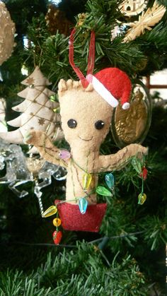 Baby Groot Christmas Tree Ornament is part of Felt crafts Geek - Give dancing baby Groot from Guardians of the Galaxy a chance to add to the Christmas spirit this season by making this cute, festive Groot ornament This little Baby Ornaments, Felt Christmas Ornaments, Diy Christmas Ornaments, Christmas Projects, Holiday Crafts, Christmas Holidays, Ornament Tree, Christmas Lights, Homemade Christmas