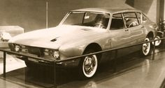 http://chicerman.com  carsthatnevermadeit:  Avanti fastback sedan prototype 1961.Raymond Loewy (pictured with the car) had hoped to develop the Avanti into a full range of models as this prototype demonstrates. With two door on the drivers side and one on the passengers it was a styling prototype designed to demonstrate how the car could be marketed as a two or four door model but the demise of Studebaker meant the saloon version never advanced beyond this one-off.  Ive posted about the…