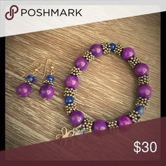 Bracelet and matching earrings Beautiful matching bracelet and earrings. Purple, blue and bronze with two charms hanging from bracelet Jewelry Bracelets