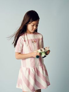 Pink and white large stripe, love it. Perfect dress for girls, feminine and sweet via Milk Magazine.