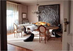 """Shabby chic, meets modern, meets the Sun King. in this Barcelona dinning room. Linen curtains, crystal chandelier, iron chairs, plastic """"S"""" chair,  French settee ‹ Menossi Fotografo"""