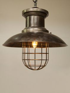 """the bristol pendant: with a strong industrial nod to loft + even seaside, the bristol, at a 22"""" diameter, offers a classic look on a new + larger modern scale. give any room an industrial or modern farmhouse look with the warm bronze glow of the bristol pendant."""