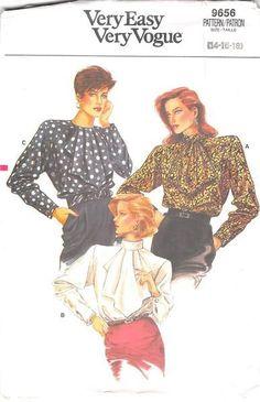 Loose-fitting blouse has jabot, extended shoulders, shoulder pads, back-button…