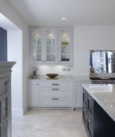 This L Shaped kitchen is functional and simplistic. Featuring a bold kitchen island in gorgeous blue hues, adding to the sophistication of the family room. White Cabinets, Home, Functional Design, Livingroom Layout, Bold Kitchen, Kitchen Collection, L Shaped Kitchen Designs, Plain English Kitchen, Kitchen Design