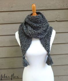 The Early Morning Wrap is an elegant wrap that takes the chill away.  Bulky yarn and and an easy to crochet stitch make a cozy wrap f...
