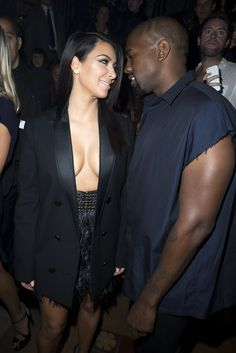 Kim Kardashian and Kanye West attend the Lanvin show as part of the Paris Fashion Week Womenswear Spring/Summer 2015 on September 25, 2014 in Paris, France.